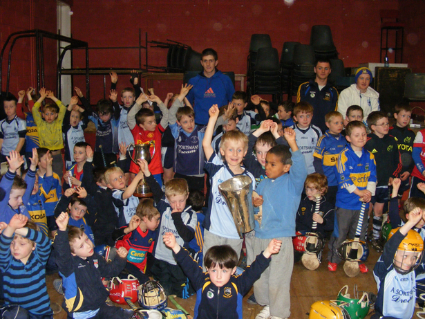 Tipperary minor hurlers Barry Heffernan, Killian Gleeson and Shane Hennessey pictured with the Irish Press Cup, Spike Nolan Cup and the County Tipperary Minor A Cup during their visit with the Nenagh Éire Óg under-6s and under-8s on Wednesday last.