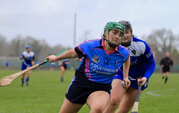 Holly O' Brien on her way to winning a penalty in her first game in two years