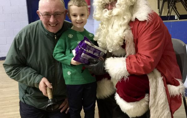 A thrilled Bartley gets to meet Santa Claus and ring his bell in MacDonagh Park
